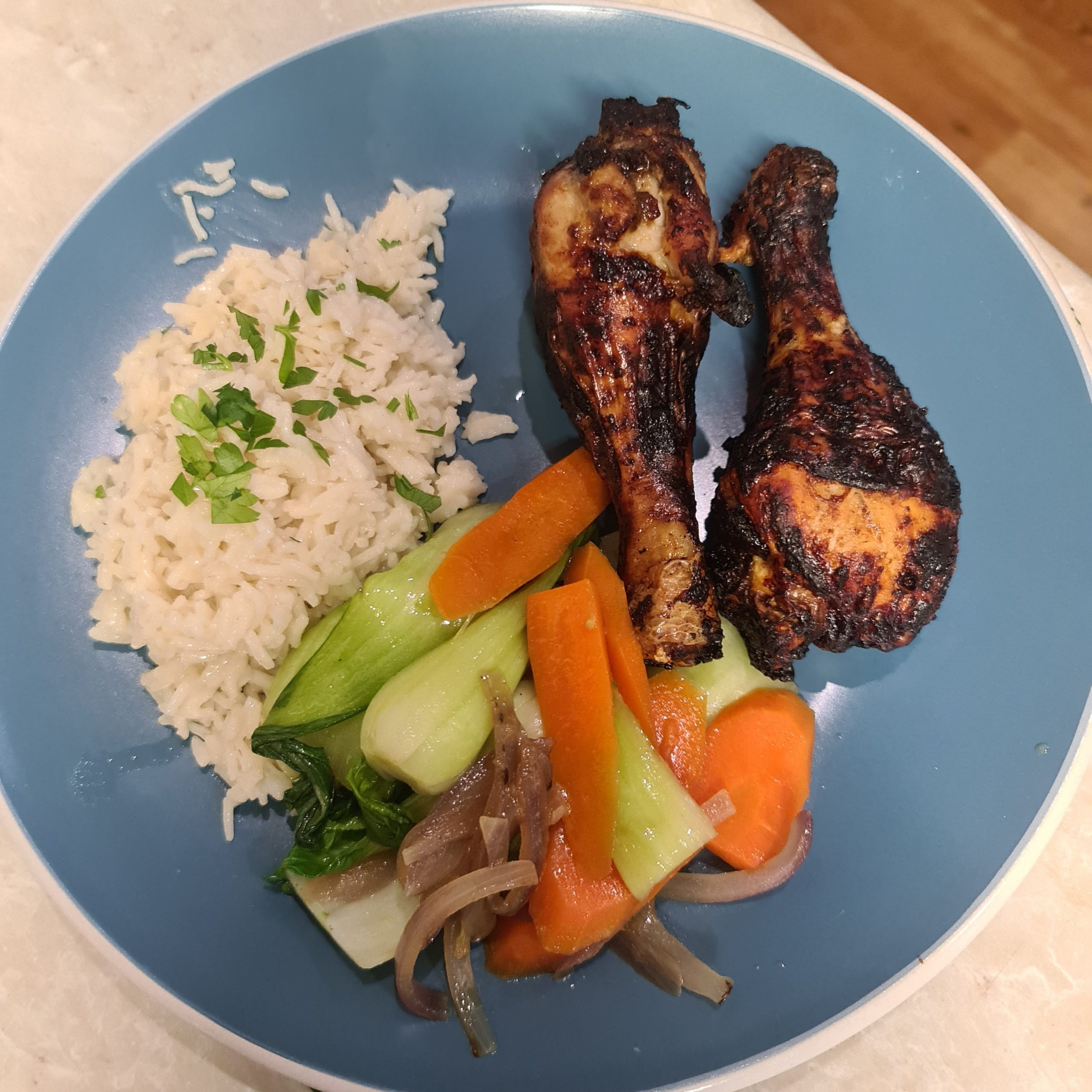 Crispy chicken with coconut rice and stir fry vegetables